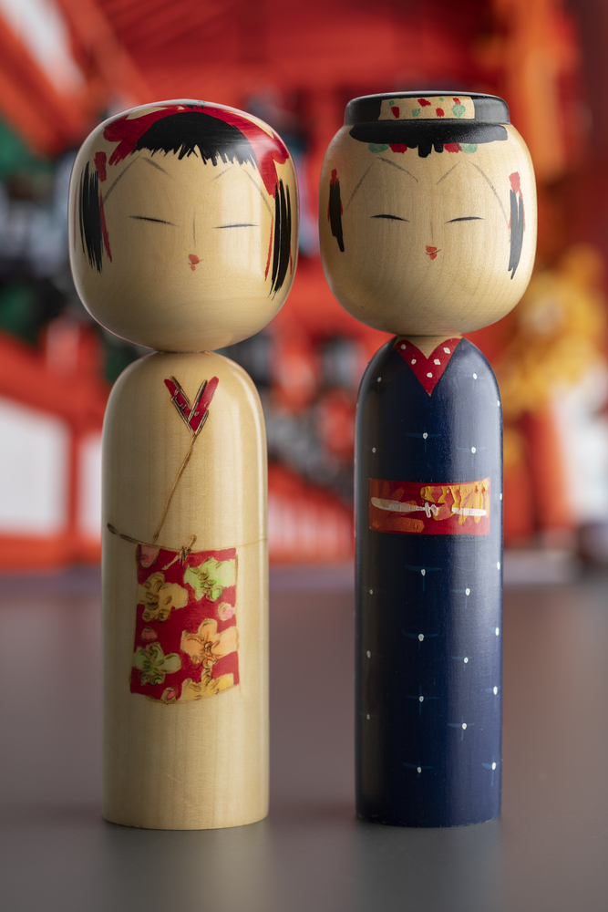 Pair of traditional wooden Japanese kokeshi dolls
